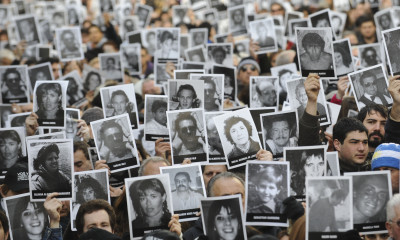 18 Jul 2012, Buenos Aires, Argentina --- People during the eighteenth anniversary ceremony of the bombing of the AMIA Jewish Mutual, holding portraits from the killed people in the attack, Buenos Aires, Argentina, July 18, 2012. The Argentina Jewish Mutual Association (AMIA) called on the Argentine government to 'redouble' the demand to the UN to clarify the bombing of the Jewish institution in Buenos Aires, where 18 years ago 85 people killed. Photo: Sergio Goya/dpa/au --- Image by © Sergio Goya/dpa/Corbis