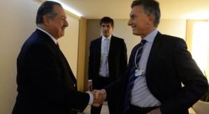 Macri y Reyser en Davos junto al CEO de Dow, Andrew Liveris.